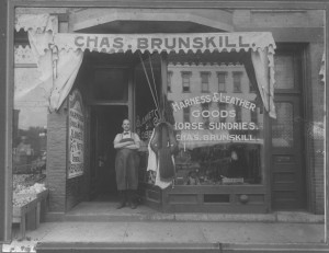 man standing in front of a store