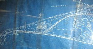 Blueprint showing lakeshore, roads, trees, insdustrial areas, meadow and a lagood. Shows Andes stove plant.