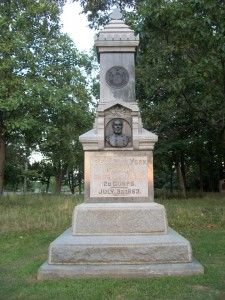Granite monument with the NY seal above a a carving of a man's head and shoulders above the words 126th New York Infantry, 3d Brig, 3d Div, 20 Corps. July 3d, 1863.