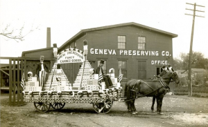 photo-of-a-horse-drawn-wagon-full-of-canned-goods-in-front-of-a-building-labeled-geneva-preserving-office