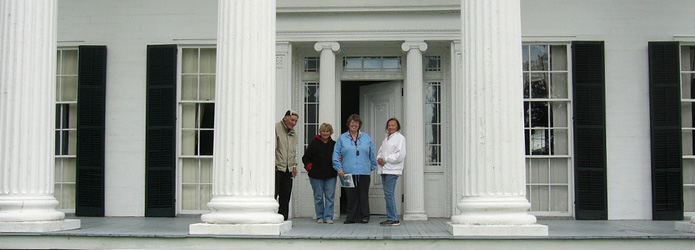 people-on-the-front-porch-of-rose-hill-mansion
