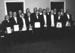 A group of men in tuxedos and masonic aprons posing for the camera.