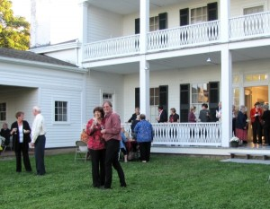 People enjoying wine and food on the grounds at Rose Hill Mansion.