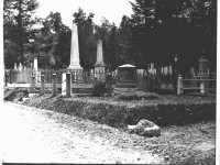 black-and-white-photo-of-several-cemetery-plots-including-swift-monument-in-washington-street-cemetery