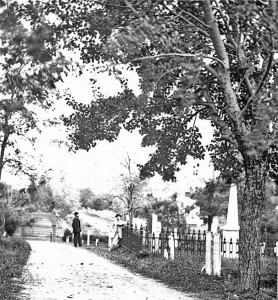 Black and white photo of two men in Washington Street Cemetery