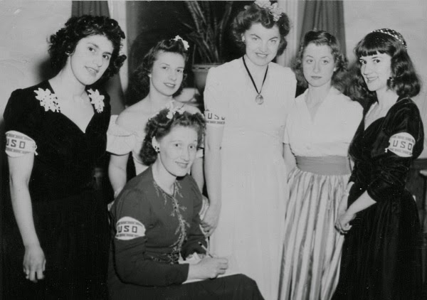 Group of five young women wearing USO armbands
