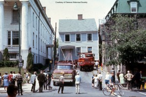 Colored photo of the Ludlow House being moved down William Street