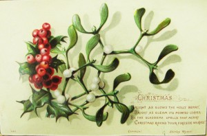A Christmas postcard with a sprig of holly.