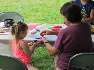 Woman and child doing a craft.