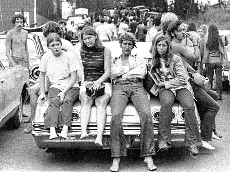 Black and white photo of young adults at woodstock in 1969