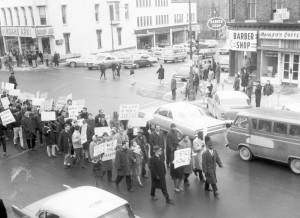 people-marching-in-downtown-geneva-in-1965