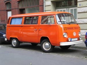 Colored image of an orange Volkswagen Transporter