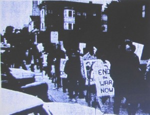 Black and white image of an anti-war protest by Hobart and William Smith students and faculty at the Geneva Armory in 1969