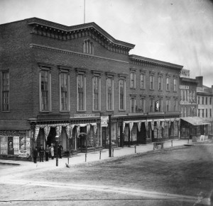 Black and white photo of Linden Hall and three other buildings on Seneca Street