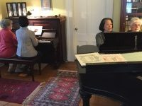 four-women-playing-two-pianos