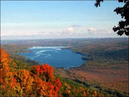 Colored photograph of an aerial view of Honeoye Lake in autumn