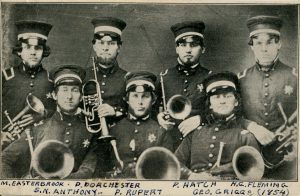 Black and white photo of a six men holding musical instruments