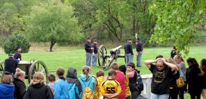 civil war re-enactors firing a cannon