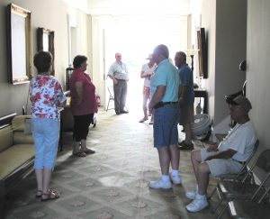 people standing in a hallway