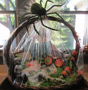 basket filled with Halloween items