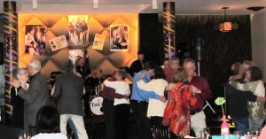 Colored image of people people dancing in the dining room of Club 86.