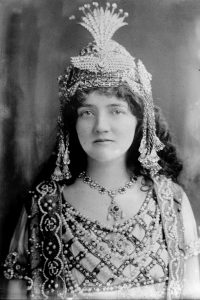 Black and white image of a woman in a costume