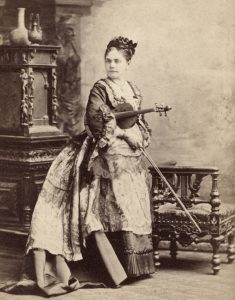 Sephia of a photo of woman posed with a violin