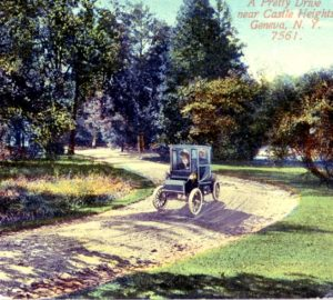 Postcard of a Model T driving near Castle Heights in Geneva.