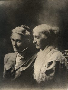 two women sitting down