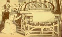 man and woman working at a power loom in a factory
