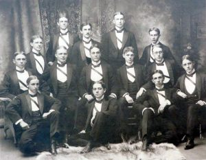 a group of gentlemen in tuxedos