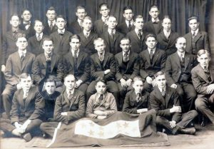 group of men and young men sitting and standing