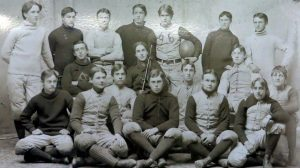 A group of young men sitting and standing