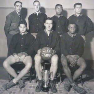 A group of basketball players with their coach