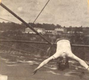 Man laying across a tightrope
