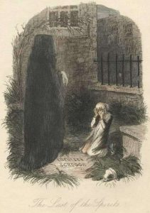 A man kneeling in front of a cloaked figure
