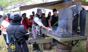 People standing around a forge