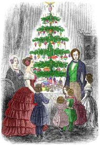 a family around a table top Christmas Tree