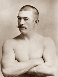 shirtless man with a moustache