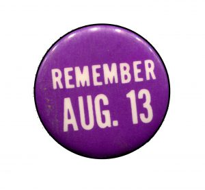 purple-button-with-remember-aug-13-on-it
