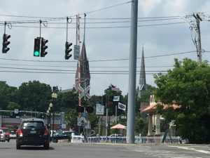 photo of a street intersection with churches in the distance