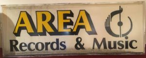 Outdoor sign for Area Records