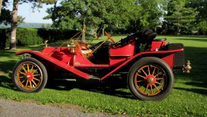 red, brass car in a lawn