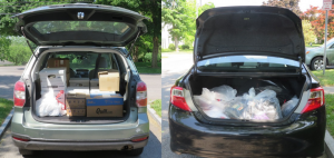 two vehicles with trunks filled with boxes and bags