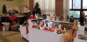 Tables filled with Christmas decorations and ornaments