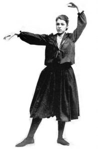 girl-posed-in-wide-bloomer-pants-shirtwaist-and-sailor-style-jacket