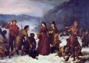 a woman and several men on a turkey hunt in the winter