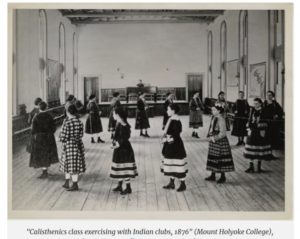 young ladies walking in a large circle