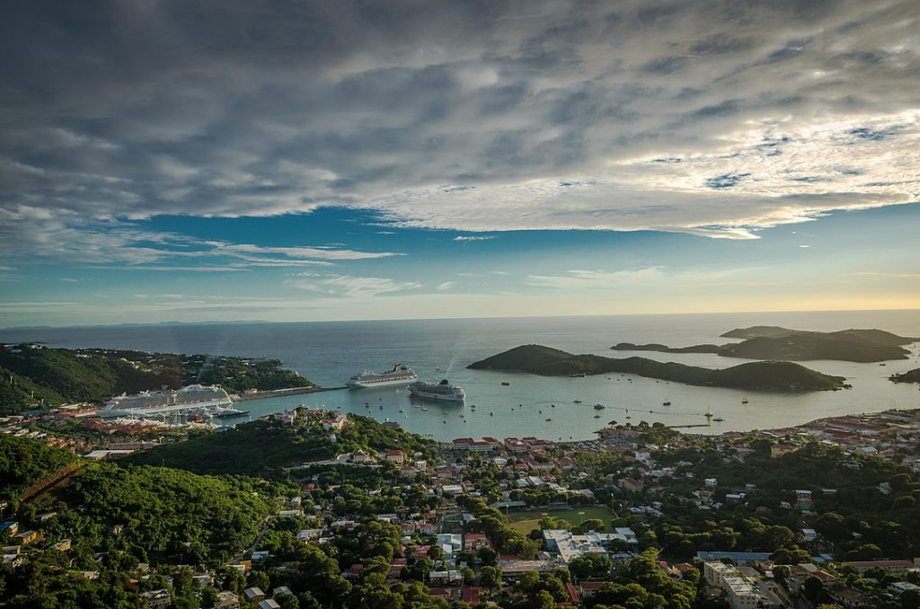 A beautiful view downhill and out to sea of a bay on St. Thomas with cruise ships docked in it.