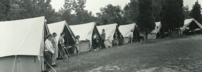 children-standing-outside-tents